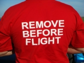 Футболка «Remove Before Flight»